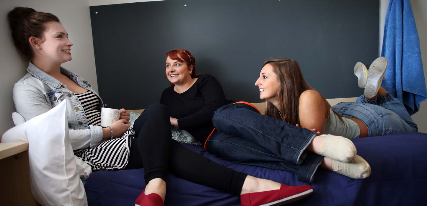 Denton Holme - girls chatting on bed,