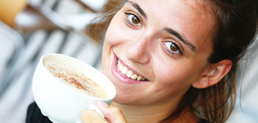 A girl with a cup of coffee