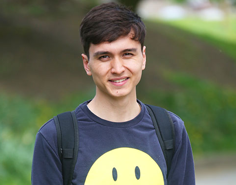boy with smiley face tshirt