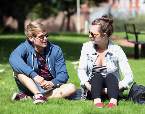 Two students sitting on grass. Original file name: denton41.jpg