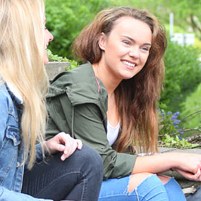 females smiling and talking